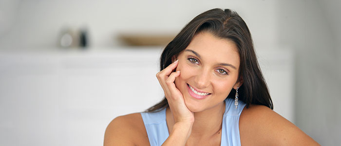 Happy Young Woman Sitting